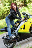 Woman standing near bike Royalty Free Stock Photos