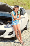 Woman is standing near broken car Royalty Free Stock Photography