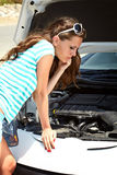 Woman is standing near broken car Royalty Free Stock Photo