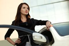 Woman standing near car Stock Image