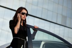 Woman standing near car Royalty Free Stock Images