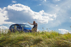 Woman standing near car Royalty Free Stock Photos