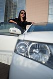 Woman standing near car, wide angle Royalty Free Stock Image