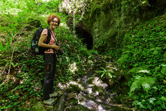 Woman standing near a cave Royalty Free Stock Images