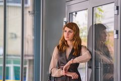 Woman Standing Near Clear Glass Gray Framed Door Panel Royalty Free Stock Photos
