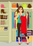Woman standing near a closet Stock Photos