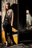 Woman standing near column wearing leather jacket Royalty Free Stock Images