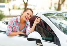 Woman is standing near the convertible car with the keys in hand Stock Photo
