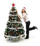 Woman standing near decorated Christmas tree Royalty Free Stock Image