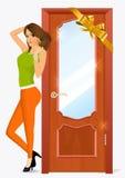 Woman standing near the door Stock Images
