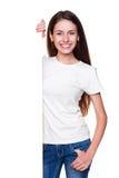 Woman standing near empty blank Stock Image