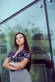 Woman standing near glass wall Royalty Free Stock Image