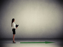 Woman standing near green arrow Stock Photos
