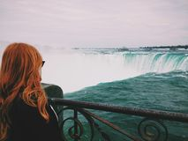 Woman Standing Near of Niagara Falls Stock Photos
