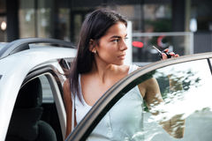 Woman standing near opened car outdoors Stock Photos