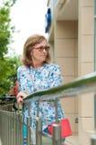 Woman standing near a railing Stock Image