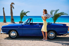 Woman standing near retro cabriolet car Stock Photography
