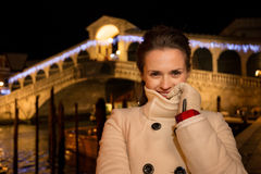Woman standing near Rialto Bridge in Christmas Venice, Italy Stock Images