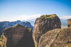Woman Standing Near Rock Cliff Royalty Free Stock Image