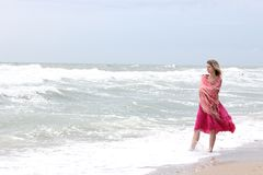 Woman standing near the sea Stock Photos