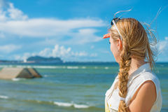 Woman standing near the sea. Royalty Free Stock Photo