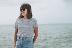 Woman Standing Near Sea While Wearing Black Frame Sunglasses Royalty Free Stock Photo