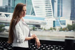 Woman standing near skyscrapers Stock Photography