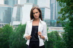 Woman standing near skyscrapers Royalty Free Stock Photography