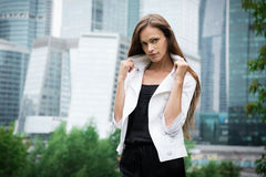 Woman standing near skyscrapers Stock Photos