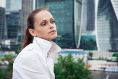 Woman standing near skyscrapers Royalty Free Stock Image