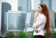 Woman standing near skyscrapers Royalty Free Stock Photo