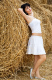 Woman is standing near a straw Royalty Free Stock Photography