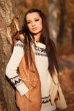 Woman standing near tree in autmn park Royalty Free Stock Photo