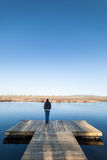 Woman standing near water Stock Images
