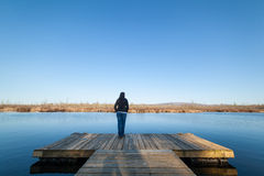 Woman standing near water Royalty Free Stock Photos