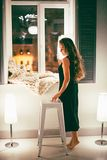 Woman Standing Near Window Beside White Stool Chair royalty free stock images