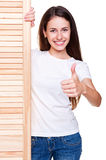 Woman standing near wood board Stock Image