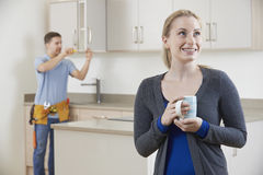 Woman Standing In New Luxury Fitted Kitchen Stock Images