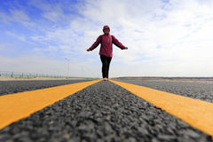 Woman standing new road in winter Stock Photos