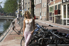 Woman Standing Next to Bicycle Royalty Free Stock Images