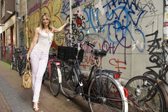 Woman Standing Next to Bicycle Royalty Free Stock Photography
