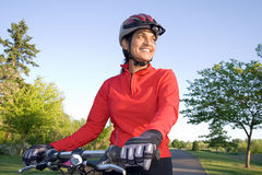 Woman Standing Next to Bicycle - Horizontal Royalty Free Stock Photo