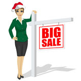 Woman standing next to big sale sign Royalty Free Stock Images