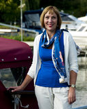 Woman standing next to a boat Royalty Free Stock Image