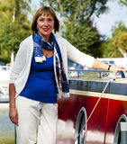 Woman standing next to a boat Royalty Free Stock Photo