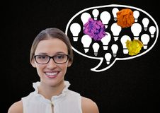 Woman standing next to light bulb chat bubble with crumpled paper balls Royalty Free Stock Photography