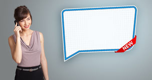 Woman standing next to speech bubble copy space Stock Photo
