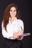 Woman standing with a notebook Stock Photo