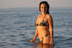 Woman Standing in Ocean. Woman in a camouflage bikini standing in the ocean, caucasian/white, age 32-45 Royalty Free Stock Photography