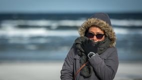 Woman standing at Ocean in Freezing weather royalty free stock images